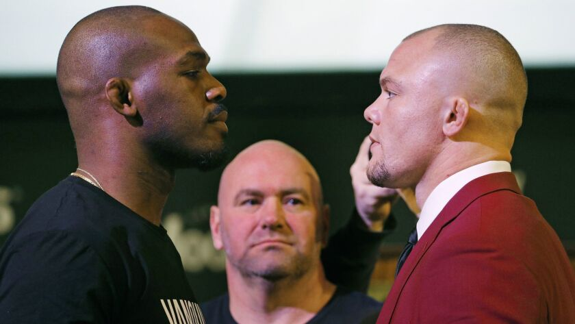 Jon Jones, left, and Anthony Smith pose for photographers during a news conference for the UFC 235 m