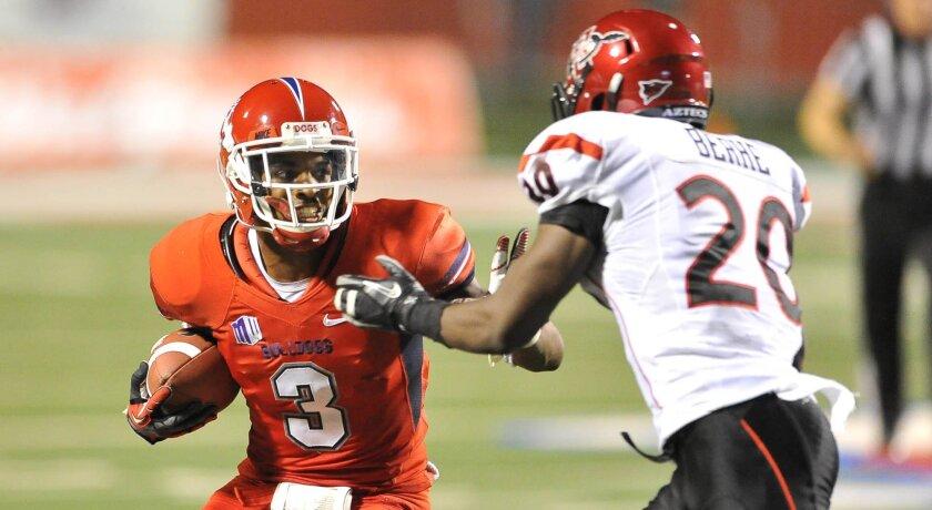 Fresno State wide receiver Josh Harper tries to get past SDSU's Nate Berhe.