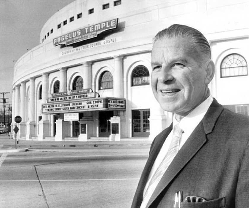Rolf McPherson outside the Angelus Temple, founded by his mother and where he served as pastor, in Echo Park in 1969. Though brought up in the church, he had been studying engineering when his mother became seriously ill in 1930 and he shifted focus. He retired in 1988.