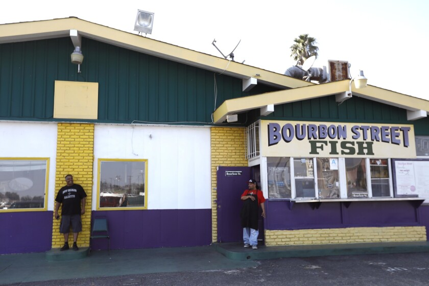 INGLEWOOD, CA - JANUARY 30, 2019 - - Derrick Brown, left, co-owner of Bourbon Street Fish & Grill, a