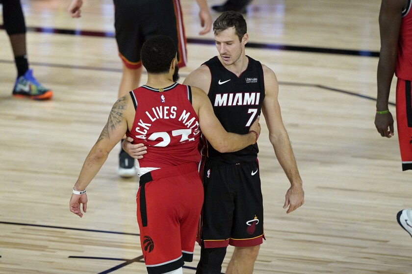 Miami Heat's Goran Dragic (7) greets Toronto Raptors' Fred VanVleet (23) after an NBA basketball game Monday, Aug. 3, 2020, in Lake Buena Vista, Fla. The Raptors won 107-103. (AP Photo/Ashley Landis, Pool)