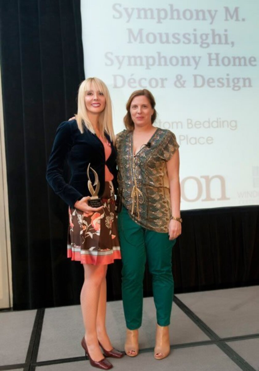 Symphony Moussighi (holding the trophy) with Susan Schultz, editor of Window Fashion Vision Magazine. (Courtesy Photo)