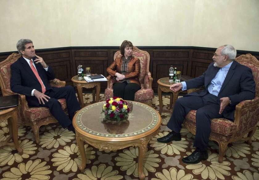 U.S. Secretary of State John F. Kerry, left, European Union envoy Catherine Ashton and Iranian Foreign Minister Javad Zarif meet in Muscat, Oman, on Nov. 10.