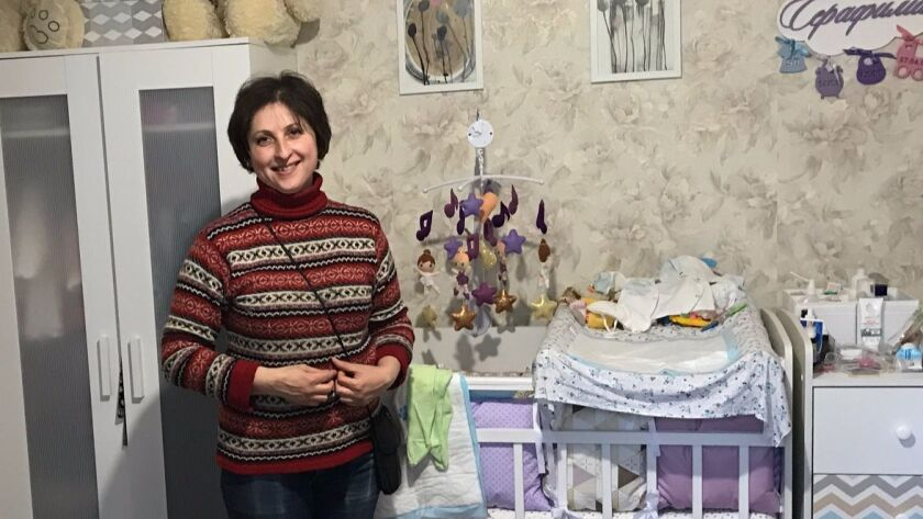 Alyona Rumyantsev, in her Moscow apartment, has helped organize opposition against plans to demolish