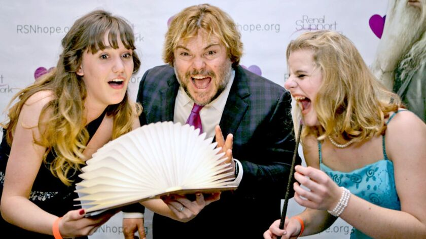 Actor Jack Black shares a few laughs with two young women who attended last year's Renal Teen Prom
