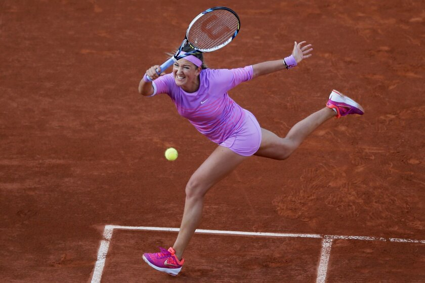 FILE - In this May 30, 2015, file photo, Victoria Azarenka of Belarus returns in the third round match of the French Open tennis tournament against Serena Williams at Roland Garros stadium, in Paris. Azarenka says she is pregnant and plans to resume her career after the baby is born. The 26-year-old Azarenka posted a letter on her Twitter account Friday, July 15, 2016, saying that when she was recovering from the knee injury that kept her out of Wimbledon, she and her boyfriend learned they were expecting a child at the end of the year. (AP Photo/Francois Mori, File)