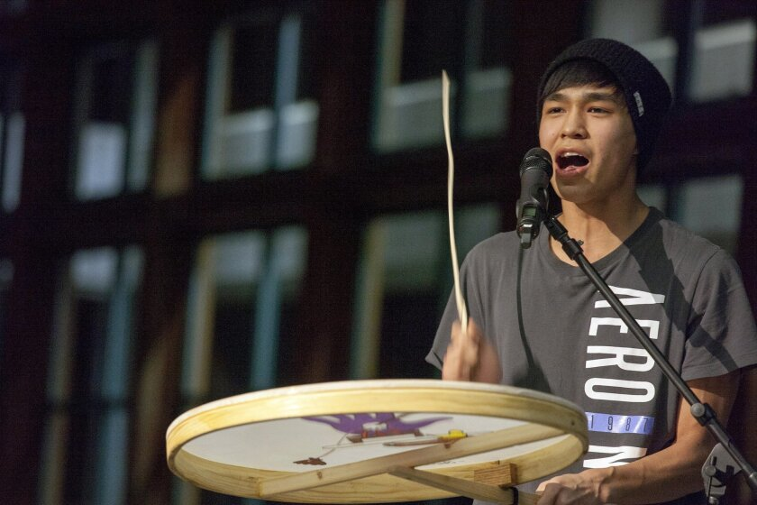 """In this Feb. 12, 2016 photo, Byron Nicholai, a performer from the Western Alaska village of Toksook Bay sings and plays his drum in Juneau, Alaska. Nicholai, an Internet sensation, runs a popular Facebook page called """"I Sing. You Dance."""" where the artist posts videos and songs.  (AP Photo/Rashah Mc"""
