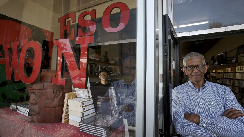 Tom Hamilton, inside left, and James Fugate are the founders and owners of Eso Won Books in Leimert Park.