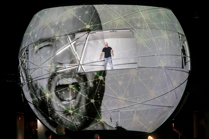 "John Brancy, singing from within the giant orb during rehearsal for Meredith Monk's ""Atlas."""