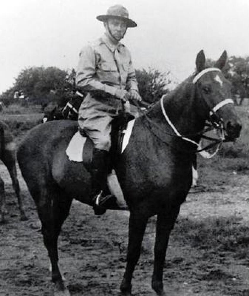 Ed Ramsey on his horse during World War II. Ramsey was a member of the 26th Cavalry Regiment and led the last mounted cavalry charge in U.S. military history.