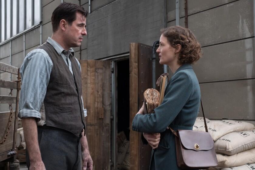 "Claes Bang and Vicky Krieps in the movie ""The Last Vermeer."""