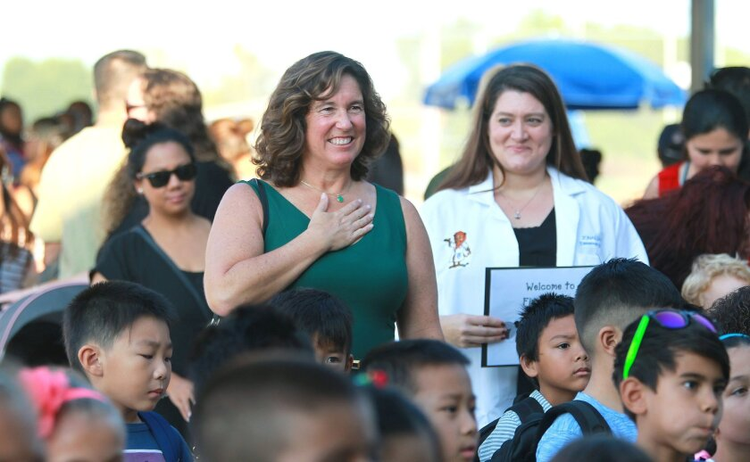 Tuesday was the first day of school at San Diego Unified and the very first day that Jonas Salk Elementary, a new school in the district. San Diego Unified School Superintendent Cindy Marten holds her hand over hear heart during the Pledge of Allegiance at Salk Elementary School.