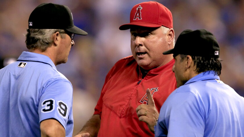 Angels Manager Mike Scioscia argues a call with umpires Paul Nauert (39) and Phil Cuzzi during the a game against the Royals in Kansas City on July 28.