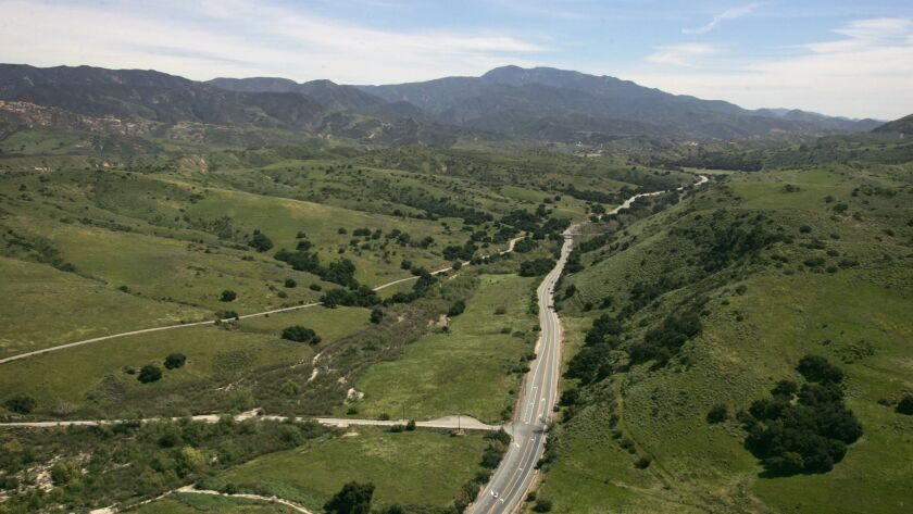 The two-lane Santiago Canyon Road meanders east toward Silverado and Modjeska canyons near Orange County's Santa Ana Mountains. An event center is planned for the Modjeska Canyon area.