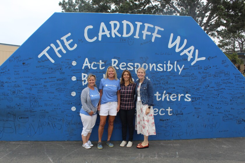 Cardiff School teacher and former student Christa Stone, Principal Julie Parker, Superintendent Jill Vinson and Cardiff School Board President Sienna Randall, also a former Cardiff student and parent.