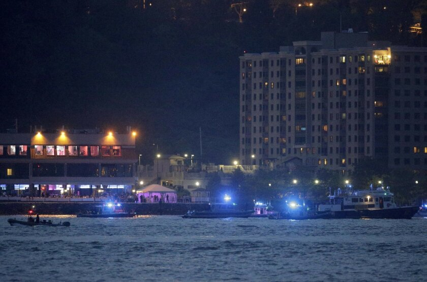 Search and rescue boats look for a small plane that went down in the Hudson River, Friday, May 27, 2016. The Federal Aviation Administration says it received a report a World War II vintage P-47 Thunderbolt aircraft may have gone down in the river 2 miles south of the George Washington Bridge. (AP