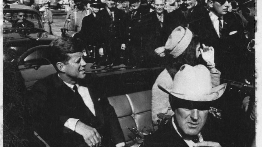 President John F. Kennedy, Jacqueline Kennedy and Texas Governor John Connally sit in a car taking them in a motorcade from the Love Field Airport to the Dallas Trade Mart on Nov. 22, 1963.