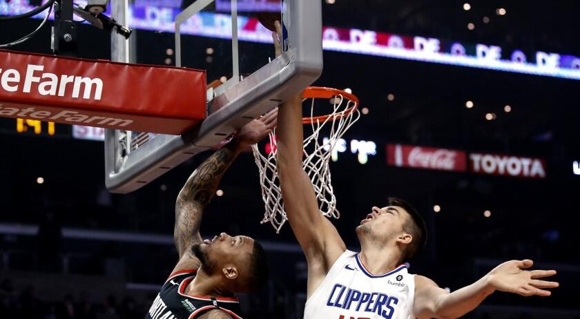 Los Angeles Clippers' Ivica Zubac, right, blocks a shot by Portland Trail Blazers' Damian Lillard du
