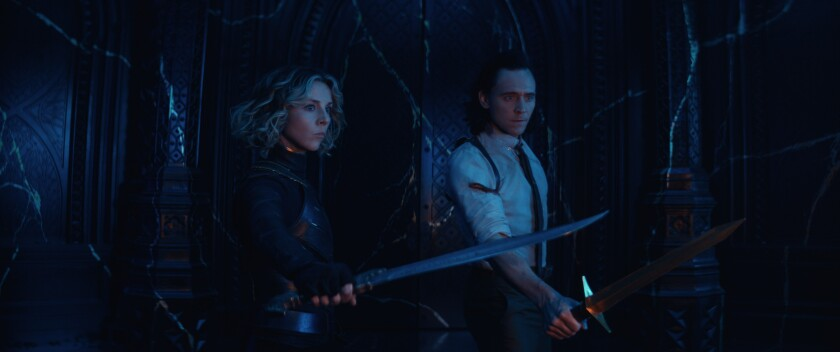 A woman and a man with their swords drawn