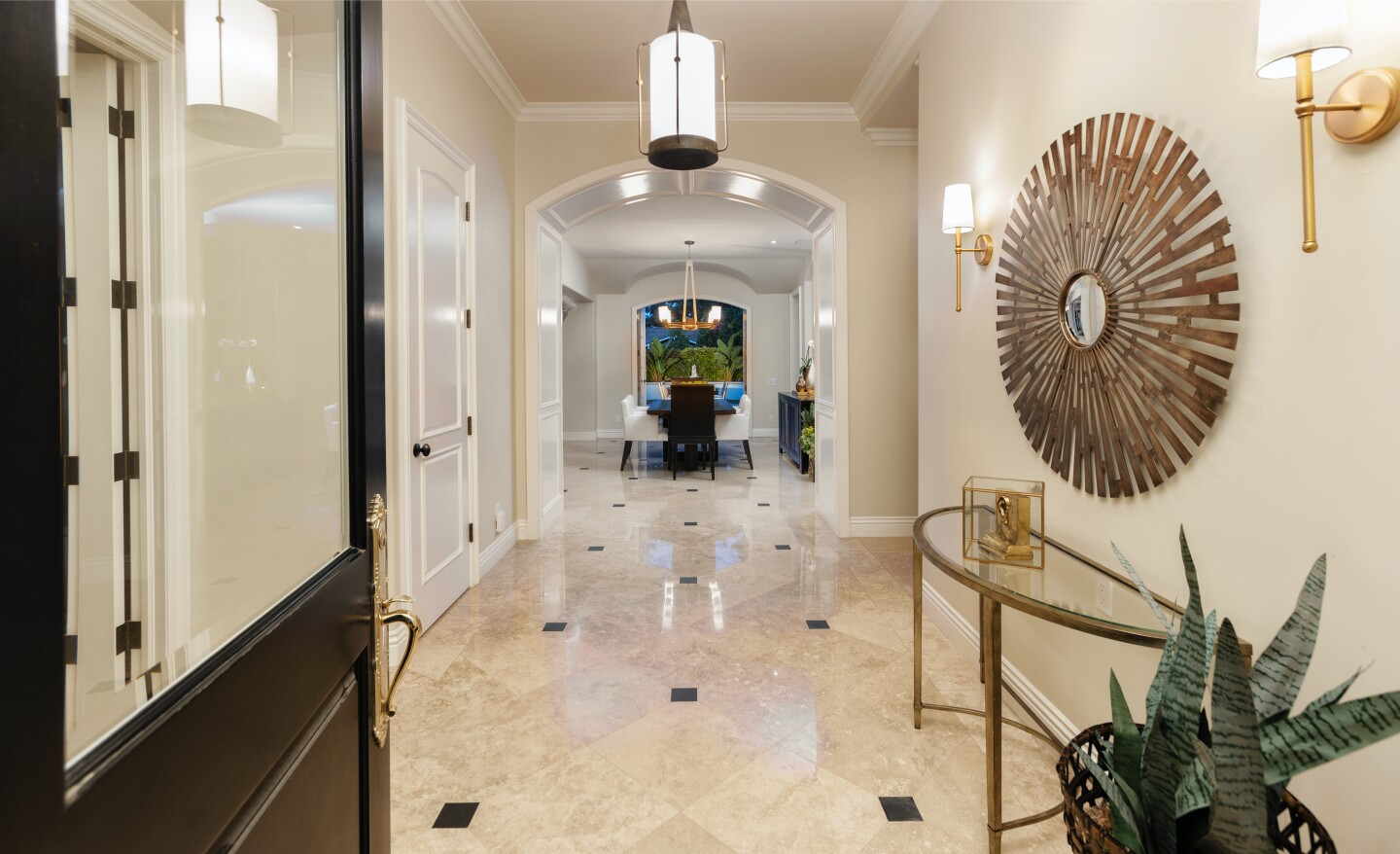 The single-story home sits about two miles from the ocean in the guard-gated golf course community of Big Canyon.