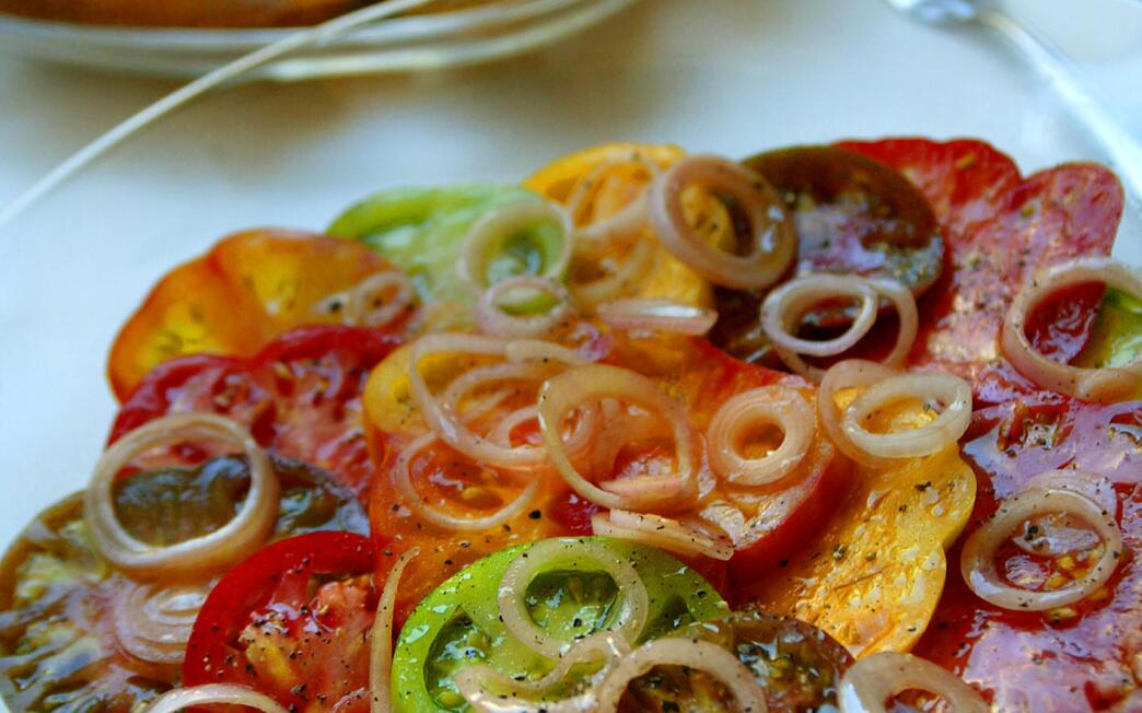Tomato salad with pickled shallots and goat cheese croutons