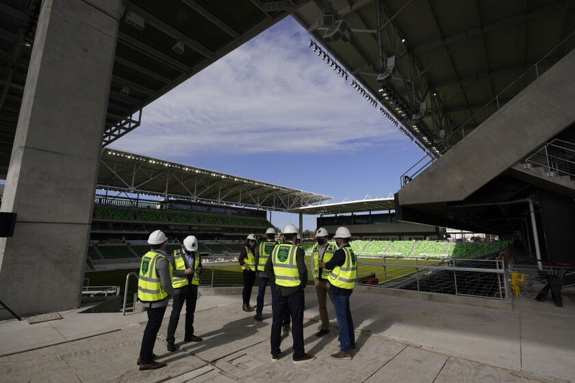 FILE - In this Jan. 25, 2021, file photo, dignitaries gather for a ribbon-cutting at Austin FC's new stadium under construction which has been named Q2 Stadium in Austin, Texas. Austin FC is MLS's newest expansion team and had to build the $260-million facility and a team roster amid the global pandemic. Austin FC opens the 2021 season Saturday, April 17, 2021, at Los Angeles FC. (AP Photo/Eric Gay, File)