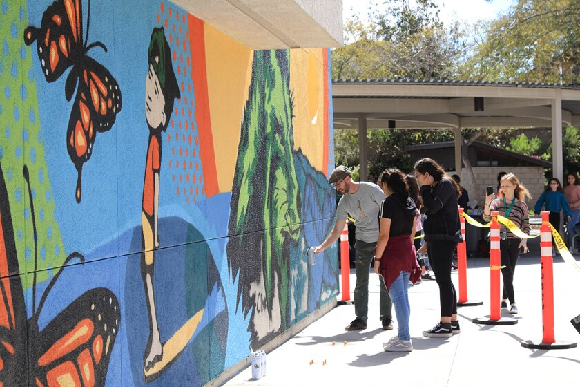 Artist Bryan Snyder was the featured guest at the recent Spring Art Festival at Calavera Hills Middle School, where he finished painting a mural including the Calavera Coyote, the school mascot.