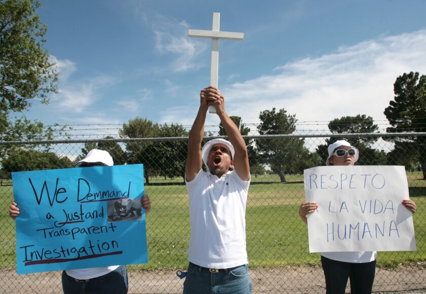 Demonstrators protest at a U.S. Border Patrol station over the shooting deaths of Mexicans.
