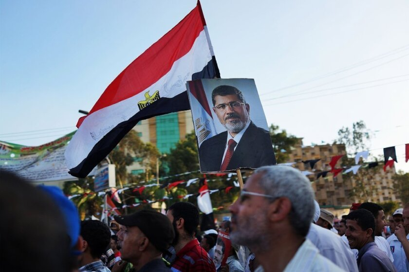 The Egyptian interim government has declared the Mohamed Morsi-led Muslim Brotherhood a terrorist organization. Above, supporters of ousted President Morsi hold a rally in Cairo on July 11.