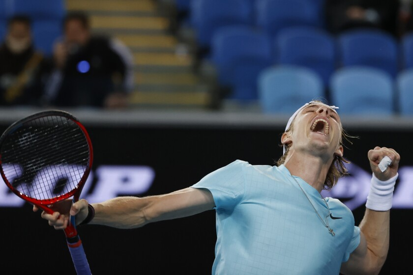 Canada's Denis Shapovalov reacts after defeating Italy's Jannik Sinner during the first round match at the Australian Open tennis championship in Melbourne, Australia, Monday, Feb. 8, 2021. (AP Photo/Rick Rycroft)