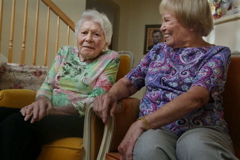 Carlsbad resident Florence Boggs, left, with her daughter Joanne Oswald. On Monday, Nov. 16, Boggs will turn 112, which aging experts say will make her the oldest living person in California.