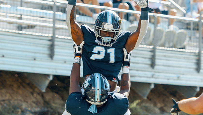 Toreros running back Jojo Binda (21) celebrates with DJ Wright after scoring a TD against Stetson on Saturday, Nov. 9, 2019.