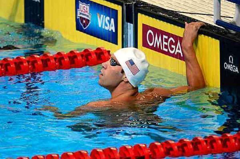 Matt Grevers checks his time after competing in a 100-meter freestyle heat on Thursday.