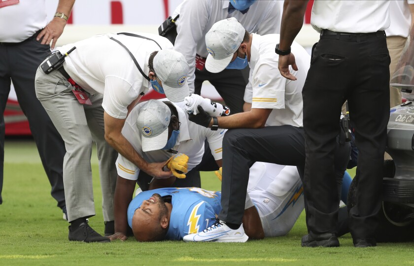 Chargers running back Austin Ekeler is attended to after suffering a hamstring injury against the Buccaneers.