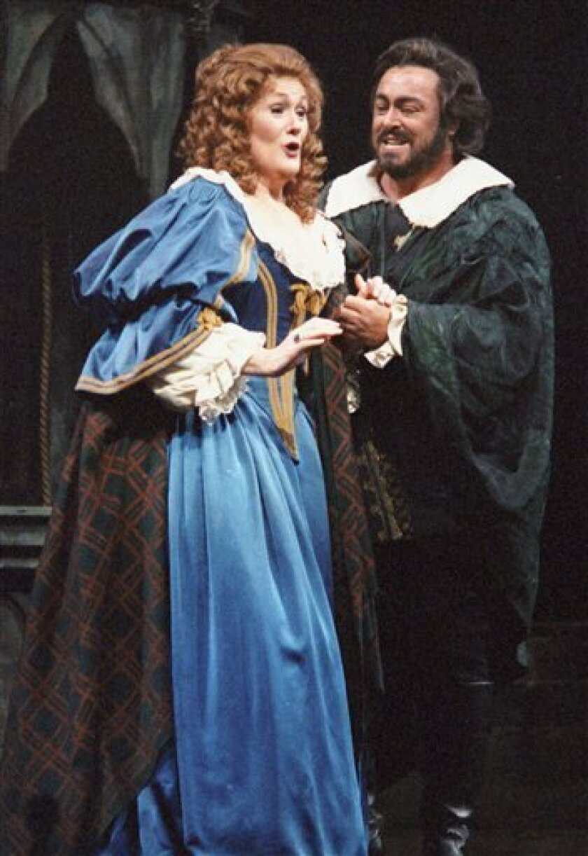 FILE - In this Friday, Jan. 10, 1987 file picture, Dame Joan Sutherland, left, and Luciano Pavarotti sing a scene from Gaetano Donizetti's opera Lucia di Lammermoor at the Metropolitan Opera in New York. Sutherland, a former small town secretarial school student whose mastery of tone, astonishing range and vocal control vaulted her into the top echelons of opera, died Sunday, Oct. 10, 2010 at 83. (AP Photo/Osamu Honda, File)