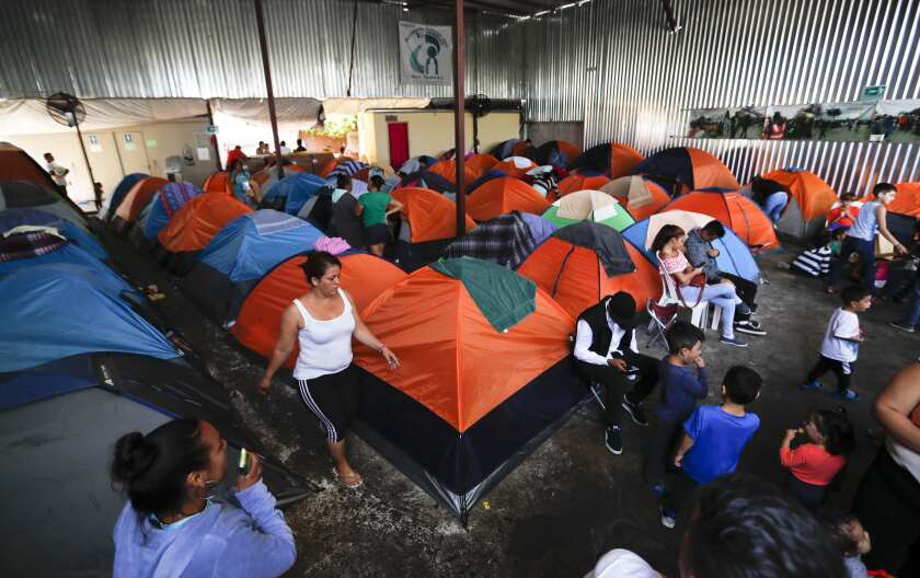 Tents fill a shelter used mostly by Mexican and Central American migrants who are applying for asylum in the U.S., on the border in Tijuana, Mexico, Sunday, June 9, 2019.