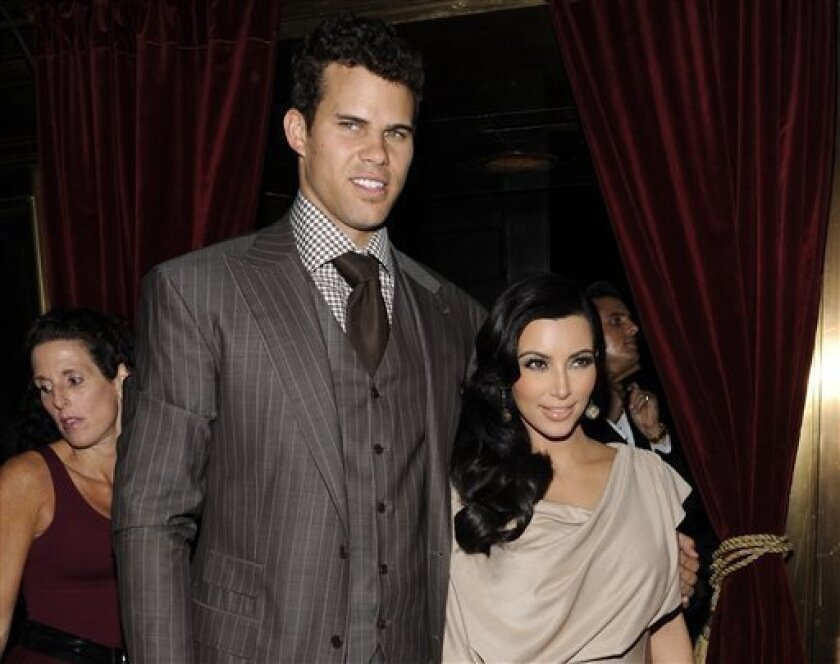 FILE - This Aug. 31, 2011 file photo shows Kim Kardashian and Kris Humphries attending a party thrown in their honor at Capitale in New York. Humphries' lawyer asked to be removed from the case on Thursday, Feb. 14, 2013, one day before a hearing is scheduled to determine when a trial should be held to end the former couple's marriage. (AP Photo/Evan Agostini, file)