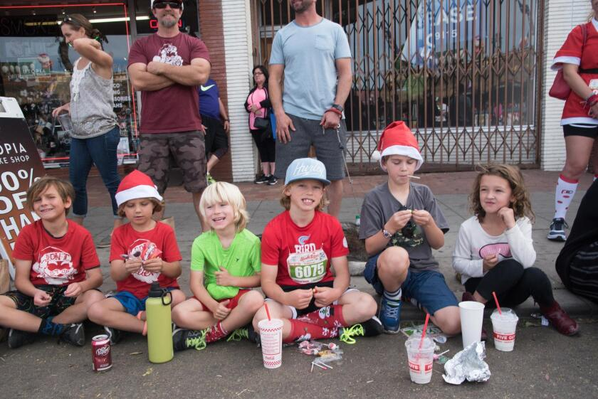 Kids enjoy the parade — and some holiday candy!