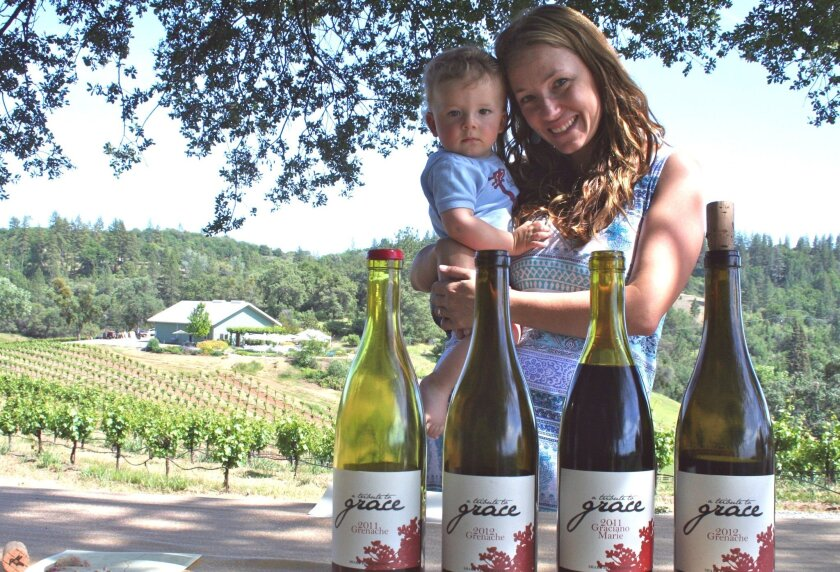 Angela Osborne with son Bodhi at the Shake Ridge Ranch vineyards in Amador County.