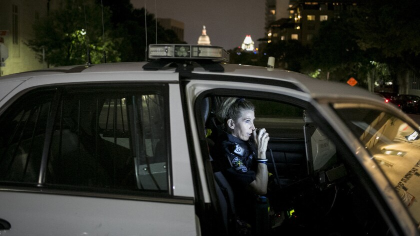 Austin police Officer Monika McCoy patrols her beat, which like her father's includes the area around the University of Texas tower,