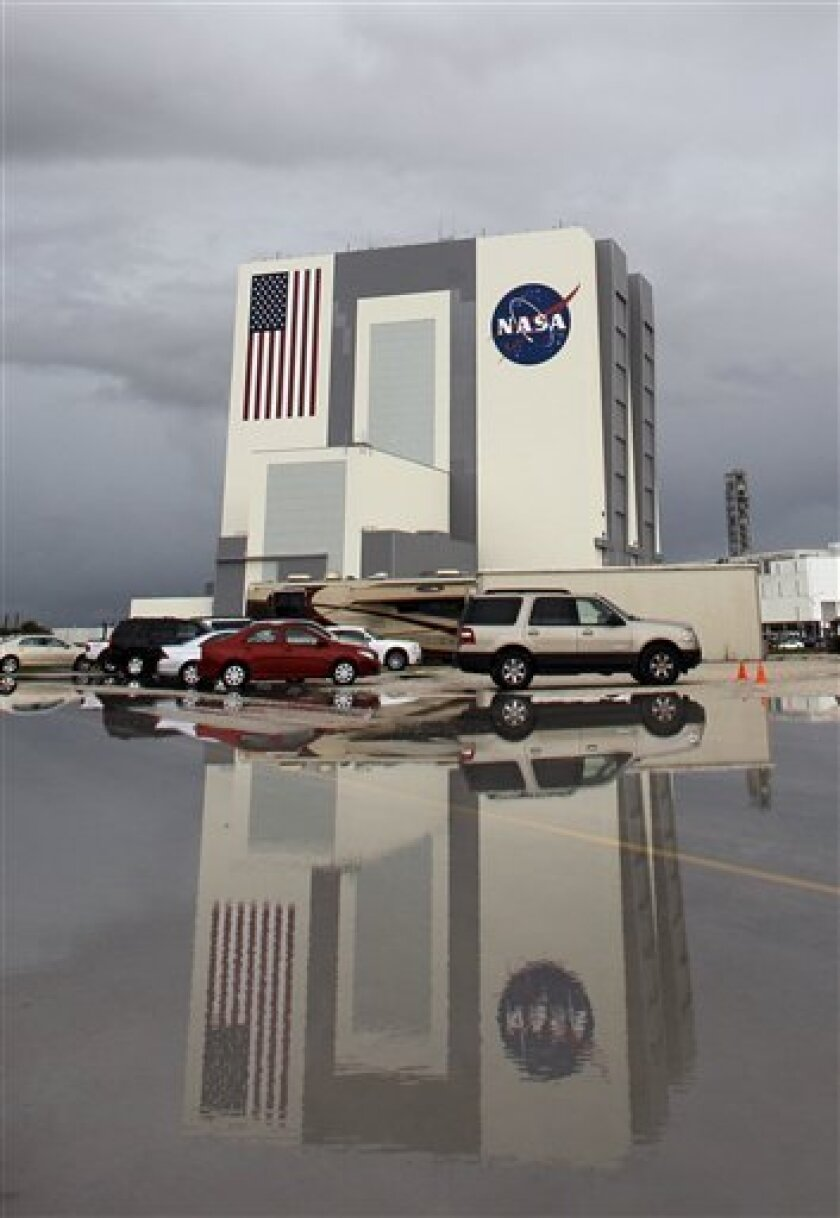 The Vehicle Assembly Building is seen after a rain shower at the Kennedy Space Center Thursday, July 7, 2011, in Cape Canaveral, Fla. The space shuttle Atlantis is scheduled to launch on Friday, July 8 and is the 135th and final space shuttle launch for NASA. (AP Photo/Chris O'Meara)