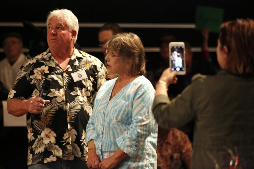 Grossmont Healthcare District Trustee Gloria Chadwick, center, announced at a town hall meeting held by Rep. Duncan Hunter Saturday that she will run against the incumbent Congressman.