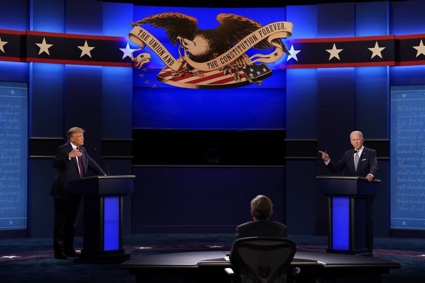 President Donald Trump, left, and Democratic presidential candidate former Vice President Joe Biden, right, with moderator Chris Wallace, center, of Fox News during the first presidential debate Tuesday, Sept. 29, 2020, at Case Western University and Cleveland Clinic, in Cleveland, Ohio. (AP Photo/Patrick Semansky)