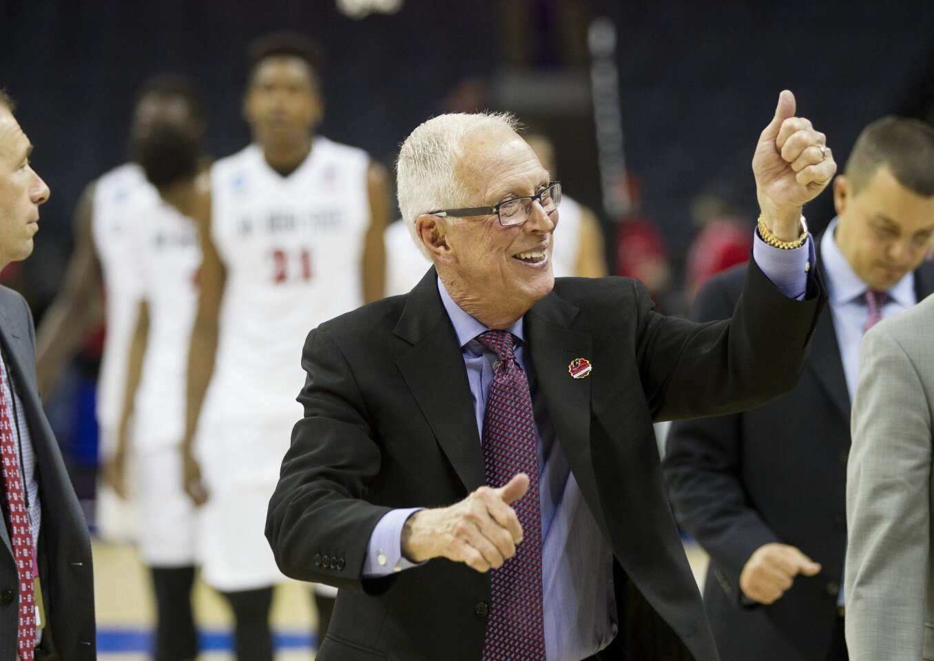 SDSU vs St. John's Mens Basketball in the second round of the NCAA Mens Basketball Tournament. SDSU Head Coach Steve Fisher gives Aztec fans the thumbs up after defeating St. John's 76-64 to advance to the next round where they will play Duke.