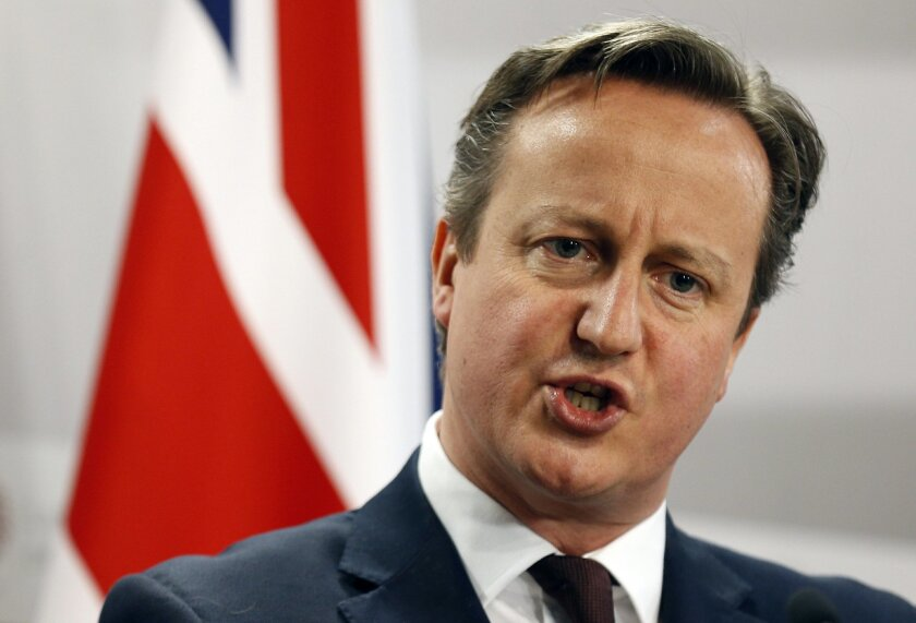 FILE - This is a Friday, May 22, 2015  file photo of British Prime Minister David Cameron as he speaks during a media conference at the conclusion of the Eastern Partnership summit in Riga, Latvia. An influential group of lawmakers says launching British airstrikes against Islamic State group milit