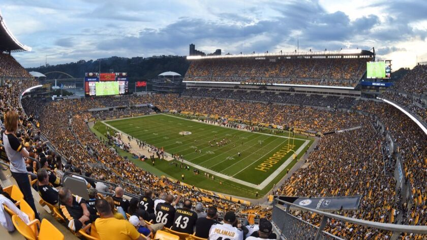 Fans watch a football game between the Pittsburgh Steelers and the Cincinnati Bengals at Heinz Field on Sunday in Pittsburgh.