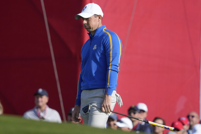 Team Europe's Rory McIlroy reacts to a putt during a foursome match the Ryder Cup at the Whistling Straits Golf Course Friday, Sept. 24, 2021, in Sheboygan, Wis. (AP Photo/Charlie Neibergall)
