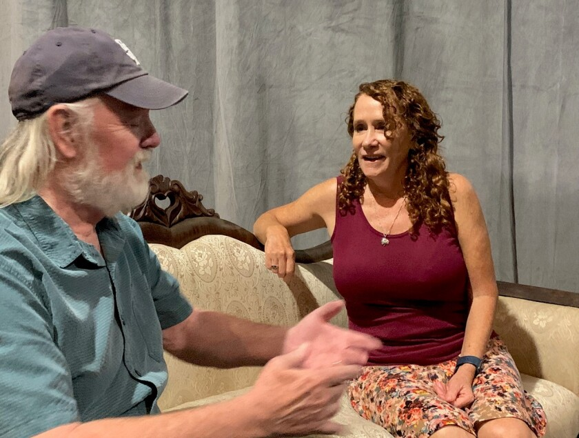 Lamb's Players Theatre's Robert Smyth, left, speaking with actor Cynthia Gerber.