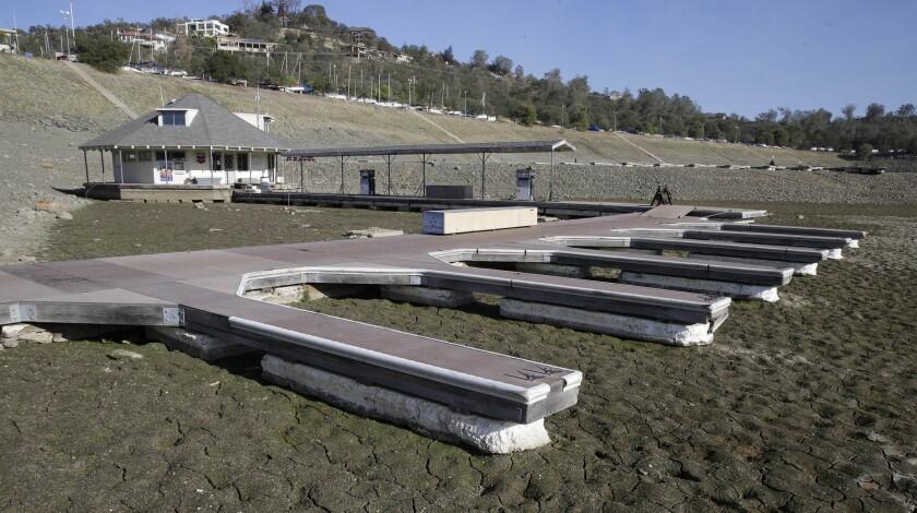 Boat slips sit on the dry lake bed at Brown's Marina at Folsom Lake, near Folsom, Calif.