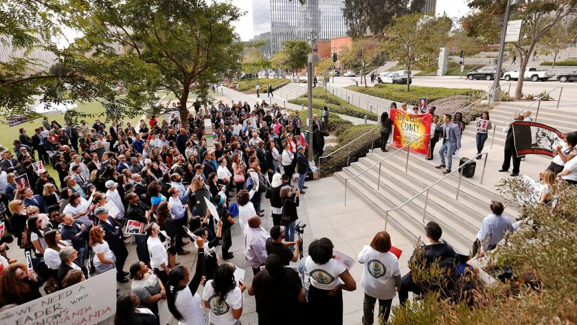 LOS ANGELES, CA – FEBRUARY 12, 2018: a crowd of deputy public defenders and supporters gathered fo